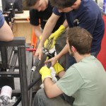 Mike, Mac, and Spark wrestling with our relief valve assembly